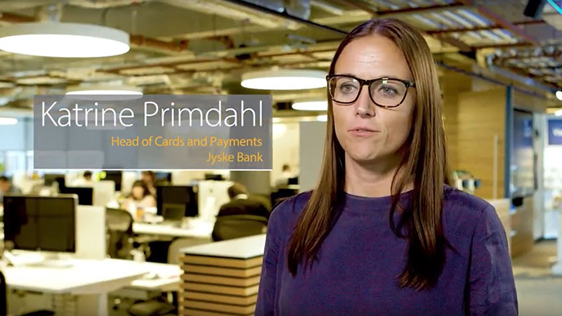 Woman named Katrine Primdahl, Head of Cards and Payments at JSKYE Bank, talks to the camera in an office space.